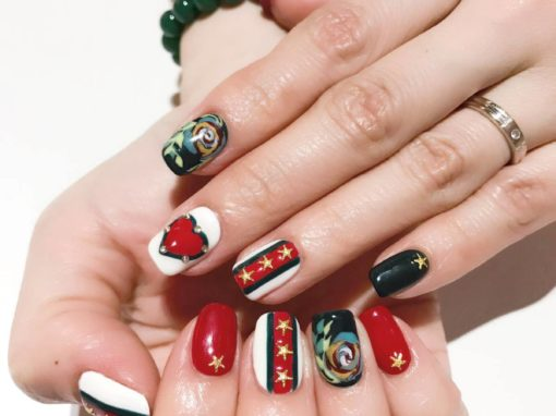 Gold stars red heart jewel studded manicure nail art