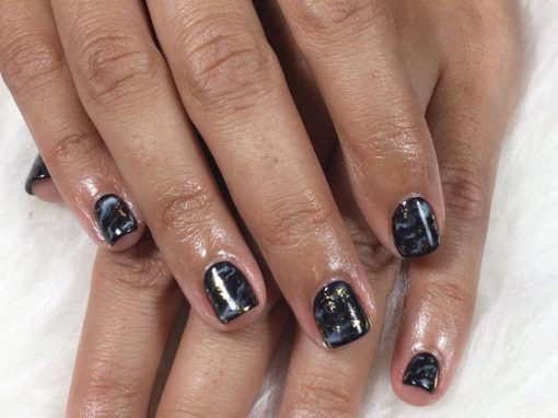 Black marble look manicure nail art with touch of gold