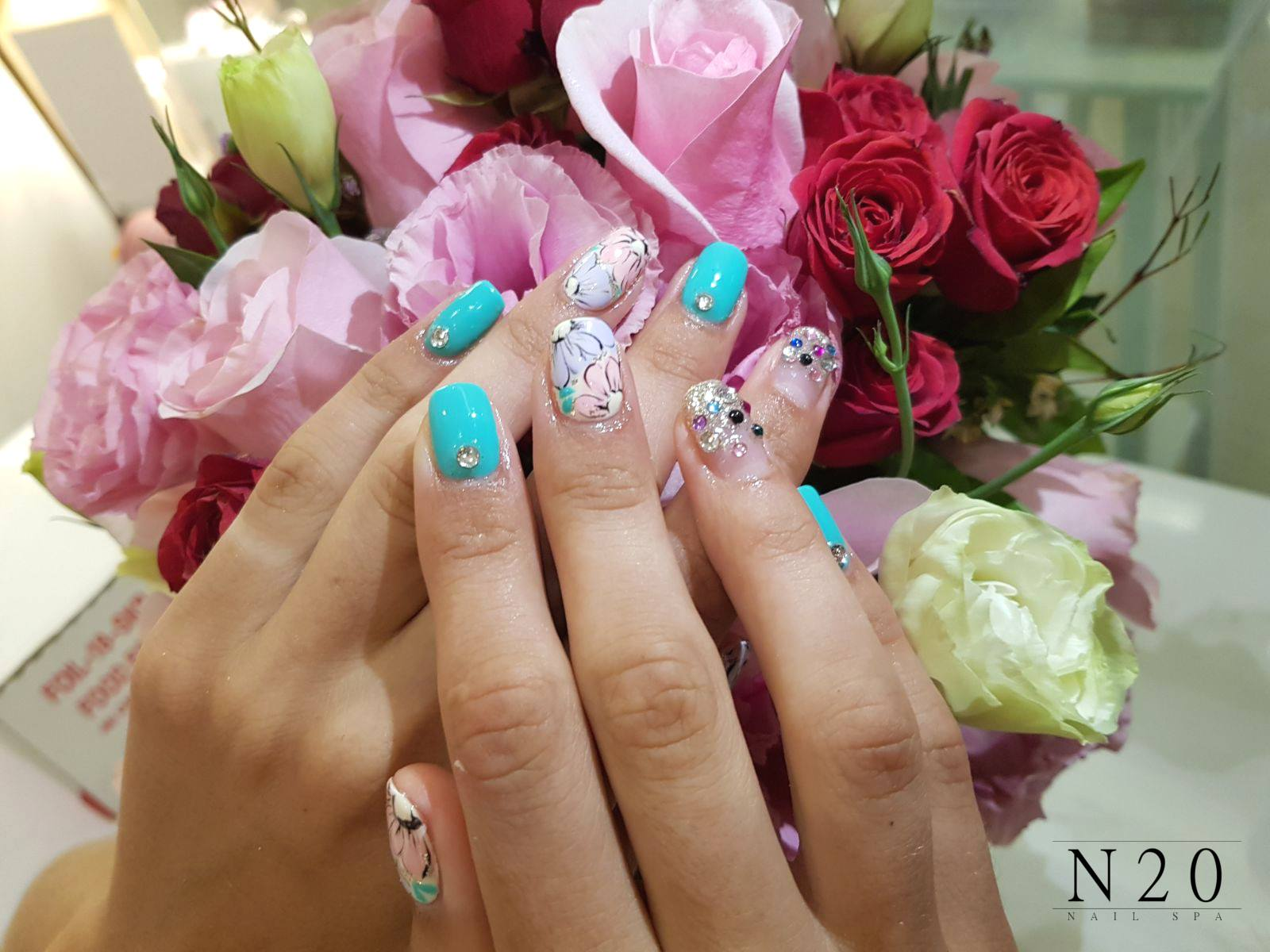 Blue pink flora manicure nail art with studs - N20 Nail Spa