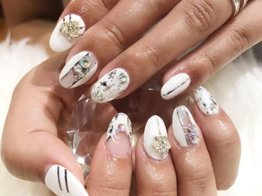 White and silver with jewel stud manicure nail art