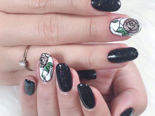 Glitter on bold black and flora on white manicure nail art