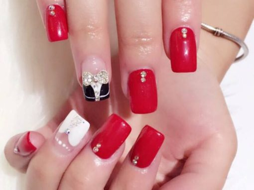 Red white manicure nail art with jewel flora