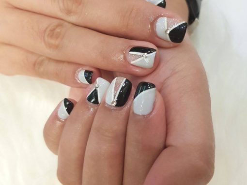 Black grey white stripe center studded manicure nail art