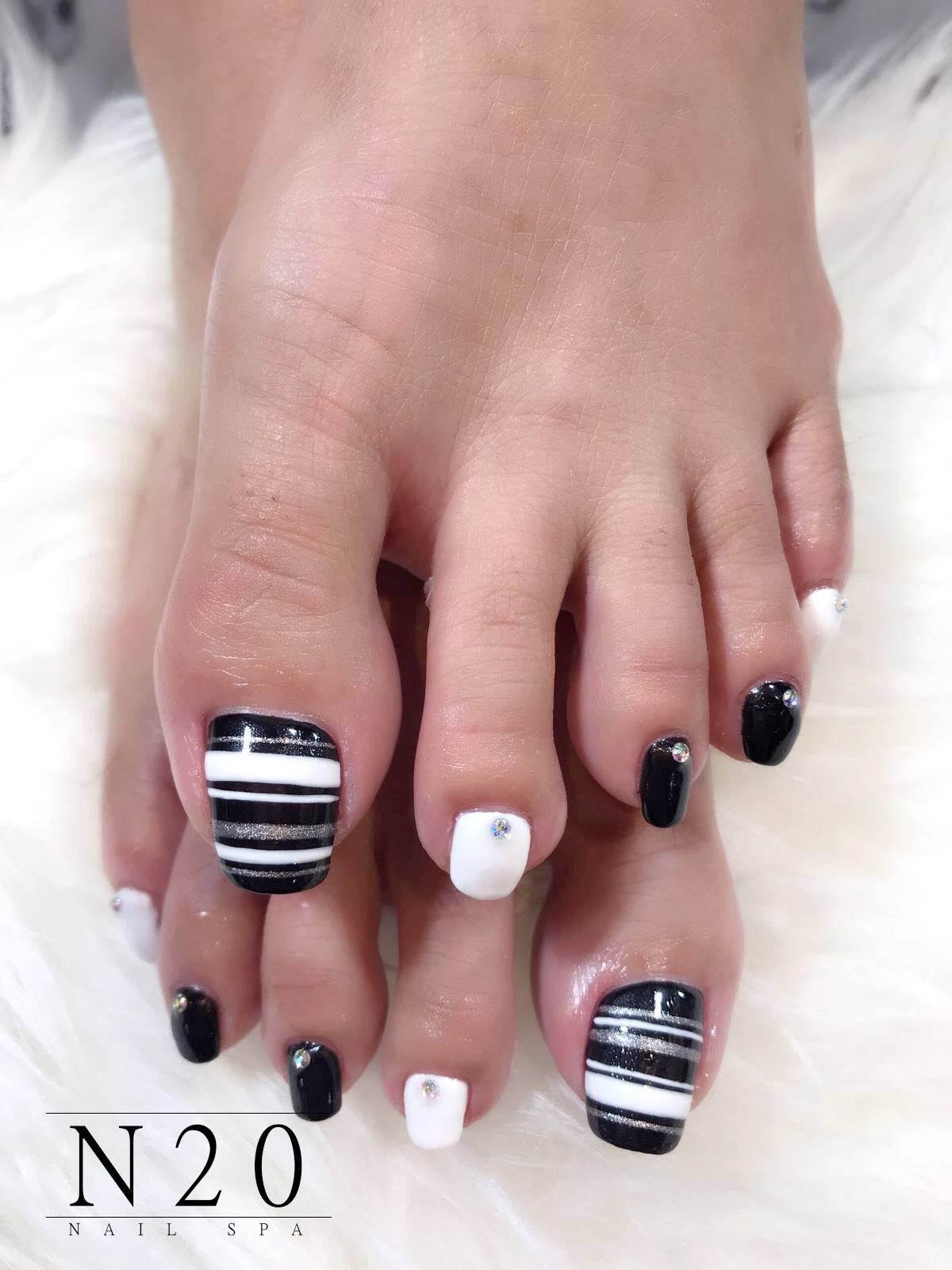 Black, White, Silver Shimmer Stripes and Studs-topped Pedicure Nail Art